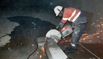 Handsaw cutting concrete wall